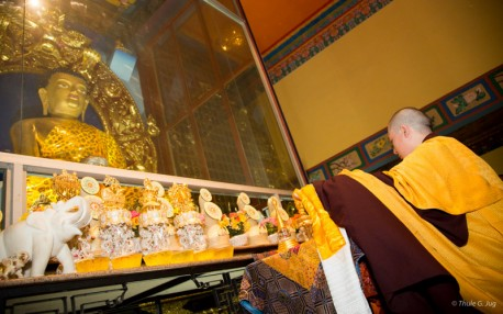 Gyalwa Karmapa brings the relics down and puts them on the big shrine in the main temple