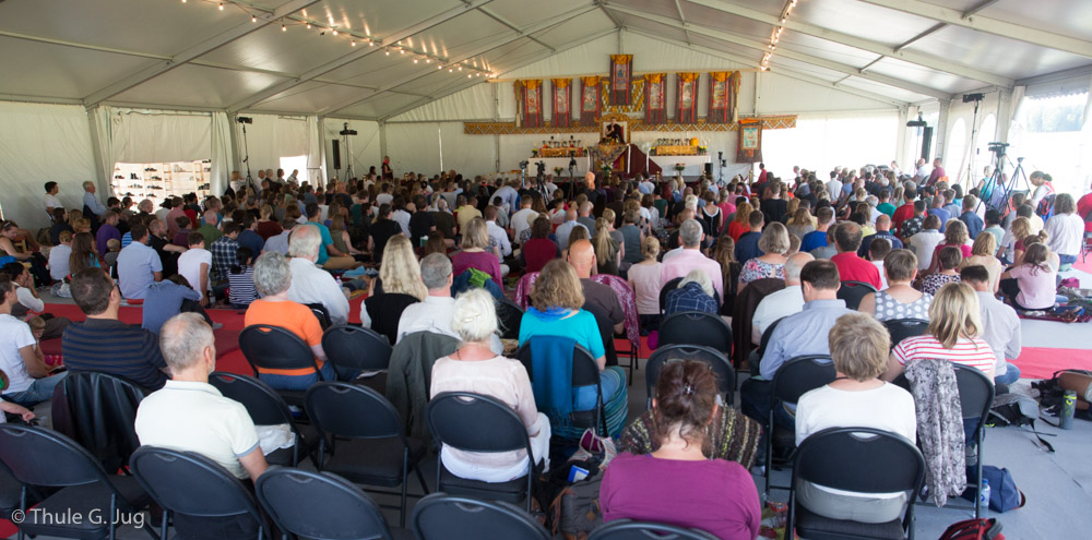 Gyalwa Karmapa gives Chenresig Empowerment with explanations to about 500 people.