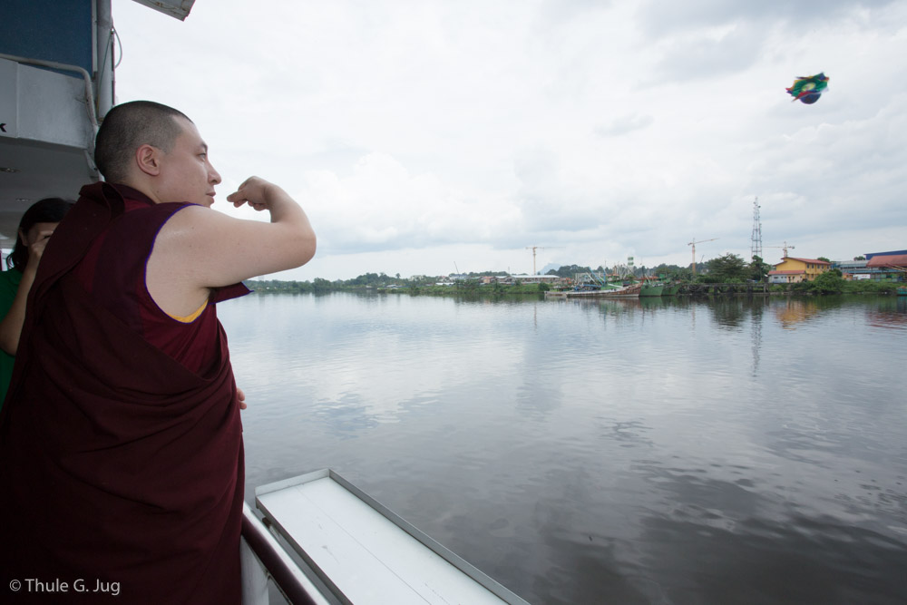 His Holiness Gyalwa Karmapa, Rinpoches and monks perform a Naga Vase Puja on board of a Sarawak River Cruise boat