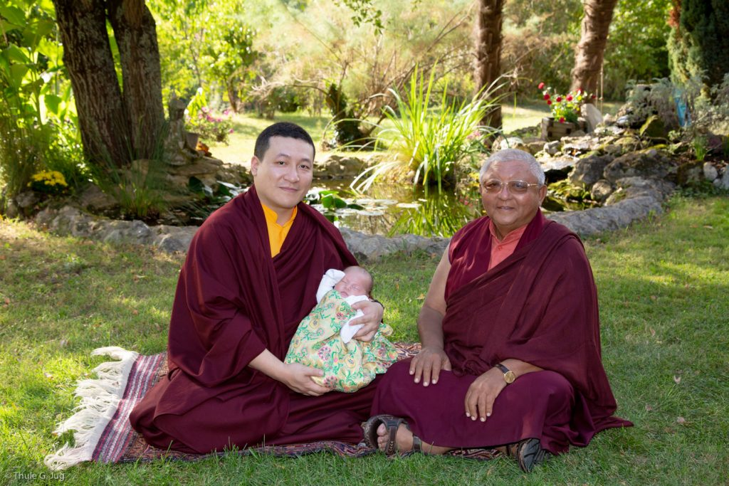 Thaye Dorje, His Holiness the 17th Gyalwa Karmapa, rests with Jigme Rinpoche, Karmapa's General Secretary, while Thugsey also takes a rest