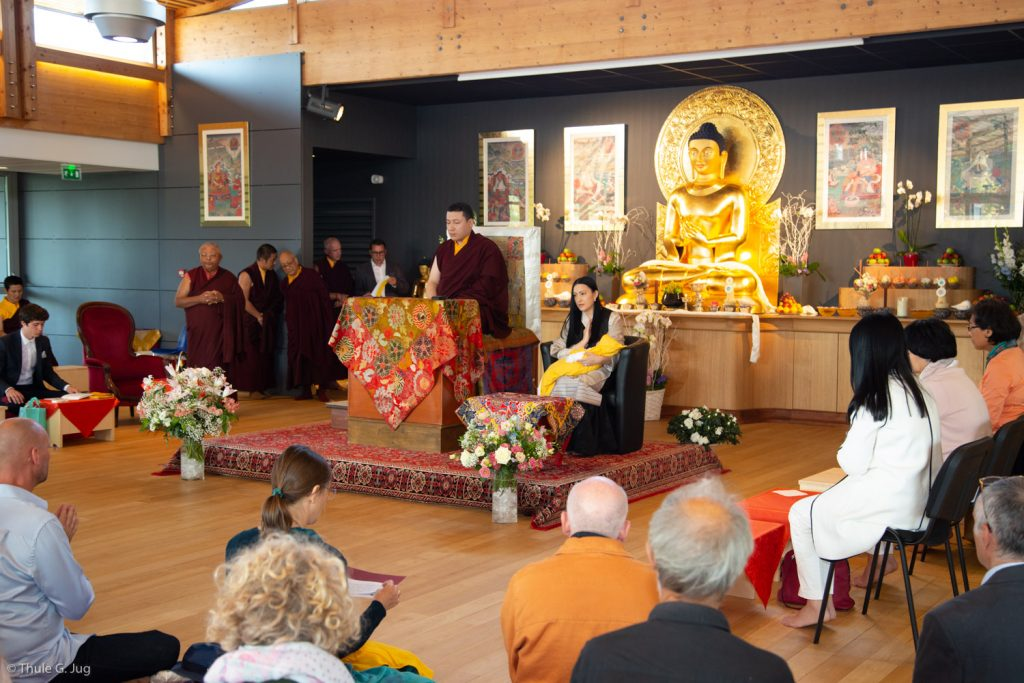 Students pray with Thaye Dorje, His Holiness the 17th Gyalwa Karmapa, Sangyumla Rinchen Yangzom, and their newborn son Thugsey at Dhagpo Kagyu Ling
