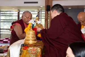 Jigme Rinpoche, Karmapa's General Secretary, makes an offering of ku sung thuk to Thaye Dorje, His Holiness the 17th Gyalwa Karmapa, during a special reception at Dhagpo Kagyu Ling