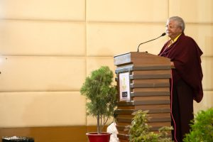 Day three of the Fourth International Karma Kagyu Meeting in Bodh Gaya. Jigme Rinpoche, Karmapa's General Secretary, speaks from the stage
