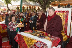 The sponsors present a Mandala Offering to Thaye Dorje, His Holiness the 17th Gyalwa Karmapa, at the Kagyu Monlam in Bodh Gaya